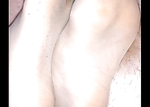 homemade footjob with ripped nylonsocks and ejaculation