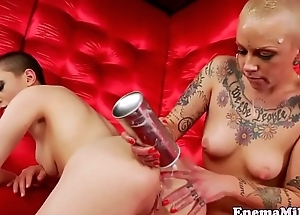 Inked enema dyke dildoed in gaping butthole