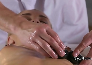 Blonde rubs cum-hole during mating with masseur