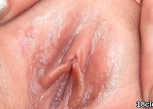 Sweet cutie is gaping narrow cunt in closeup and having orgasm