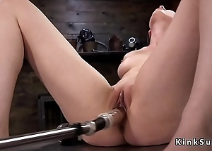 Solo brunette enjoys machine anal sex