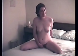 My wife posing nude on the bed
